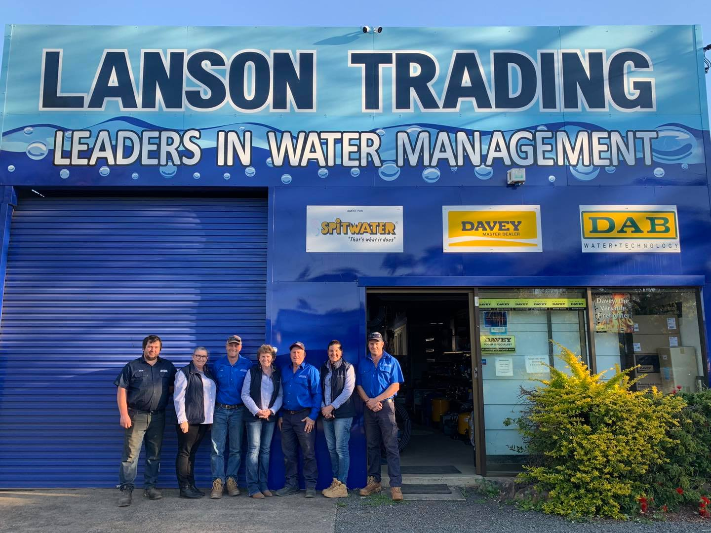 Lanson trading staff standing outside shop front.